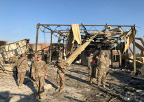 U.S. soldiers inspect the site where an Iranian missile hit at Ain al-Asad air base in Anbar provinc