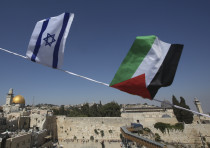 Palestinian and Israeli flags overlook Dome of Rock and Western Wall