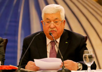 Palestinian President Mahmoud Abbas delivers a speech following the announcement by the U.S. Preside