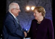 German Chancellor Angela Merkel receives Israeli President Reuven Rivlin at the Chancellery in Berli