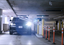 An illustration of a parking garage gate opening.