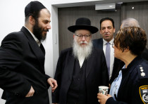 Israeli Health Minister Yaakov Litzman arrives for a situation assessment meeting regarding the nove