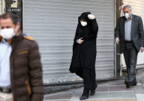Iranian people wear protective masks to prevent contracting a coronavirus, in Tehran, Iran February
