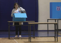A woman votes at a Jerusalem polling station on March 2