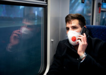A man wears a face mask for fear of the coronavirus as he takes the train to Haifa, on March 17, 202
