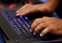 A man types into a keyboard during the Def Con hacker convention in Las Vegas, Nevada, U.S.