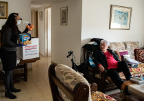 Yael Eckstein delivers food and sanitary products to Yelena Meirovitz in Hadera, Israel, one of 30,0