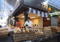 Mahane Yehuda market reopens after coronavirus restrictions had it shut down for the most part