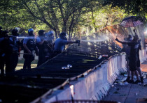 Riot police utilize pepper spray on protesters as demonstrations continue after a white police offic