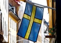 The Swedish flag is seen at Gamla Stan, the Old City of Stockholm, Sweden, May 7, 2017.