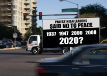 A truck displays a counter-protest slogan in the vicinity of pro-Palestinian rallies held across Ame