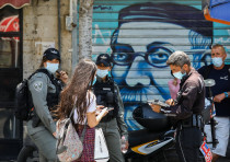 Israel Police officers giving out tickets for not wearing a mask in public