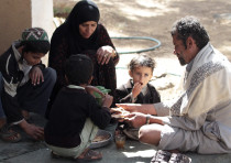 A family have breakfast outside their home at a Jewish community in Sanaa, Yemen