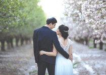 A NEW bride and groom visit a blossoming almond grove in Latrun on their wedding day in 2019.