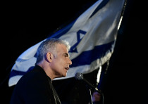 MK Yair Lapid speaks during a protest against Prime Minister Benjamin Netanyahu calling on him to qu