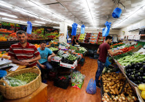 Palestinians buy vegetables and fruits at a shop during the holy month of Ramadan, in the West Bank