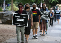 People participate in a meditation walk in support of Black Lives Matter organized by the Portland B