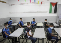 Palestinian students arrive to their first day of school in Nablus, West Bank ,on September 6, 2020.