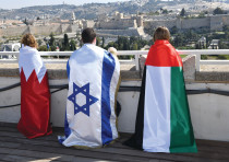 The Gulf-Israel Women's Forum brings children draped in the flags of Bahrain, Israel and the UAE to