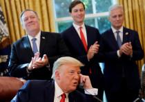 Secretary of State Mike Pompeo and White House senior advisor Jared Kushner applaud as US President