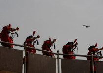 Members of the police band play the bugle to mark the tenth anniversary of the November 26, 2008 ter