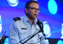 Acting Chief of Police Motti Cohen speaks at the annual Justice conference in Airport City, outside