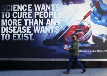 A person walks past the Pfizer Headquarters building in the Manhattan borough of New York City, New