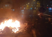 Haredi protesters burn garbage in protest of the light rail construction in their ultra-Orthodox nei