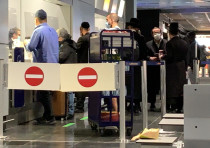Israeli passengers wait to board the Lufthansa flight intended to bring them back to Israel, Februar