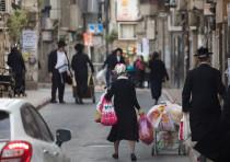 A typical street scene in the bustling modern-day shtetl of Jerusalem's Mea She'arim neighborhood.