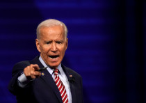 Democratic 2020 US presidential candidate and former Vice President Joe Biden reacts during a televi