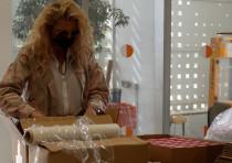 Former Israeli Supermodel Michaela Bercu helps pack boxes of food for the needy in Yeruham
