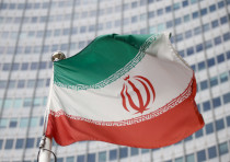 The Iranian flag waves in front of the International Atomic Energy Agency (IAEA) headquarters, befor