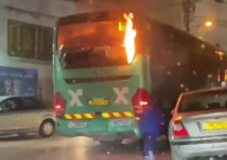 A bus burning from Molotov cocktails in the east-Jerusalem neighborhood of Isawiya, April 9, 2021.