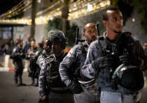 Police Officers stand guard during clashes between Palestians and Israeli police outside Damascus Ga