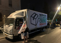 """A fake moving truck titled """"Crime Minister Movers"""" on Balfour comes to """"Take Bibi home"""""""