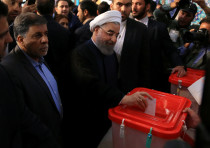 Iranian President Hassan Rouhani casts his vote during the presidential election in Tehran