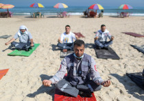 Palestinian paramedics perform yoga on International Day of Yoga, on a beach in Gaza City