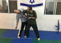 Katz demonstrates Krav Maga with a colleague.  'We rely on sound techniques and the natural body mov