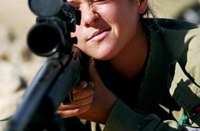 female soldier shoots (photo credit: IDF)