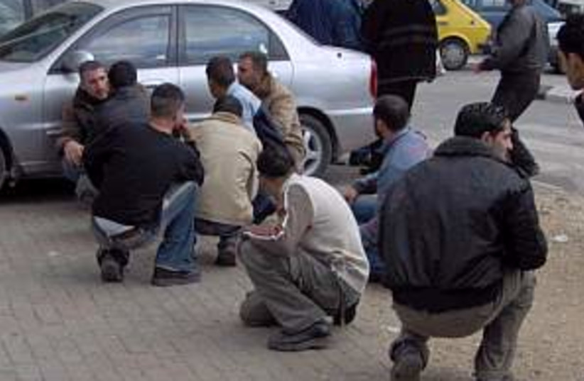 hamas fatah clashes (photo credit: AHMAD GHARABLI)