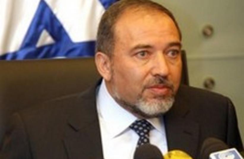 Lieberman with flag 248 88 aj (photo credit: Ariel Jerozolimksi [file])
