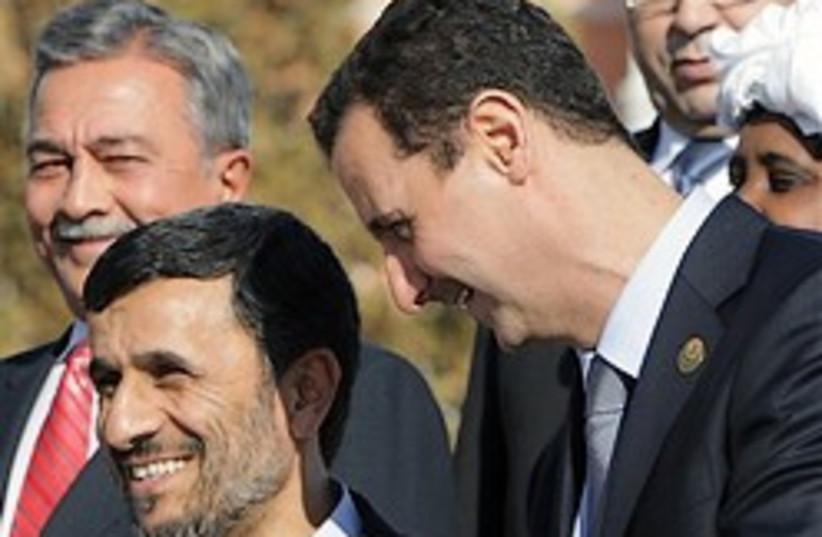Assad and Ahmedinejad chat 248.88 (photo credit: )