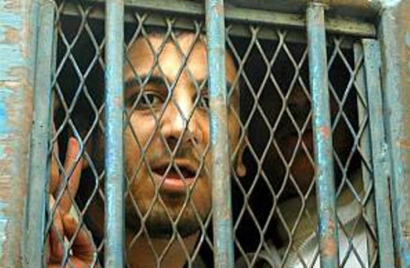 egypt blogger jail 298 (photo credit: AP)