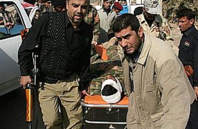 iraq casualty 298.88 (photo credit: AP)