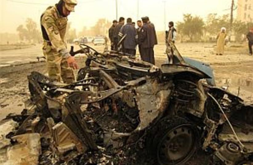 iraq blasted bus 298.88 (photo credit: AP)