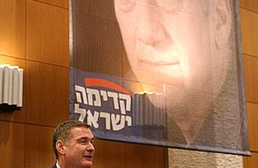 ramon near olmert poster (photo credit: Ariel Jerozolimski)