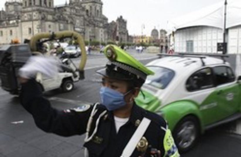 swine flu mexico cop 248 88 (photo credit: AP)