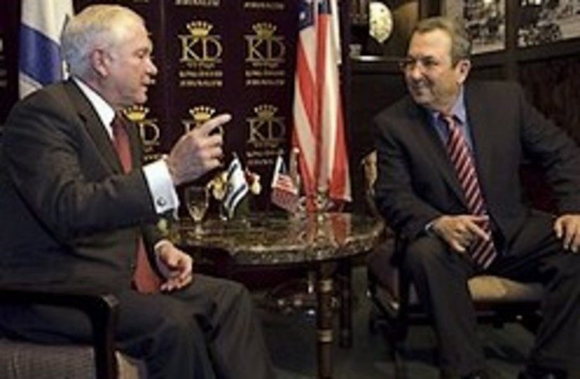 US Defense Secretary Robert Gates, left, shakes ha (photo credit: AP)