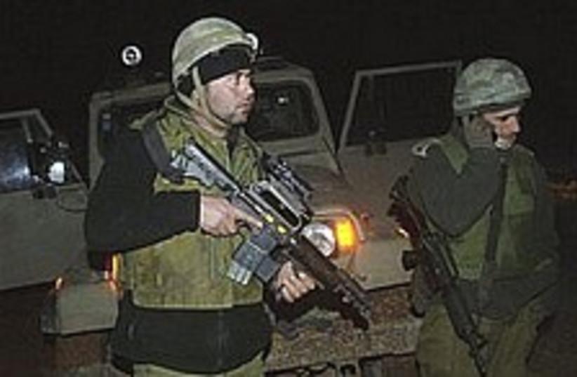 IDF troops border 298.88 (photo credit: AP [file])